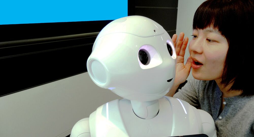 IBM Research - Tokyo is IBM Researcher Risa Nishiyama with SoftBank's Pepper robot using Watson in a demonstration environment.