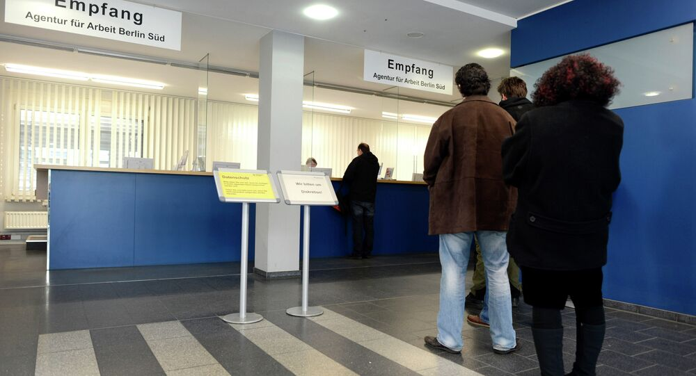 Job seekers stand in front of the reception at a unemployment centre Agentur fuer Arbeit , at the district Kreuzberg in Berlin, Germany