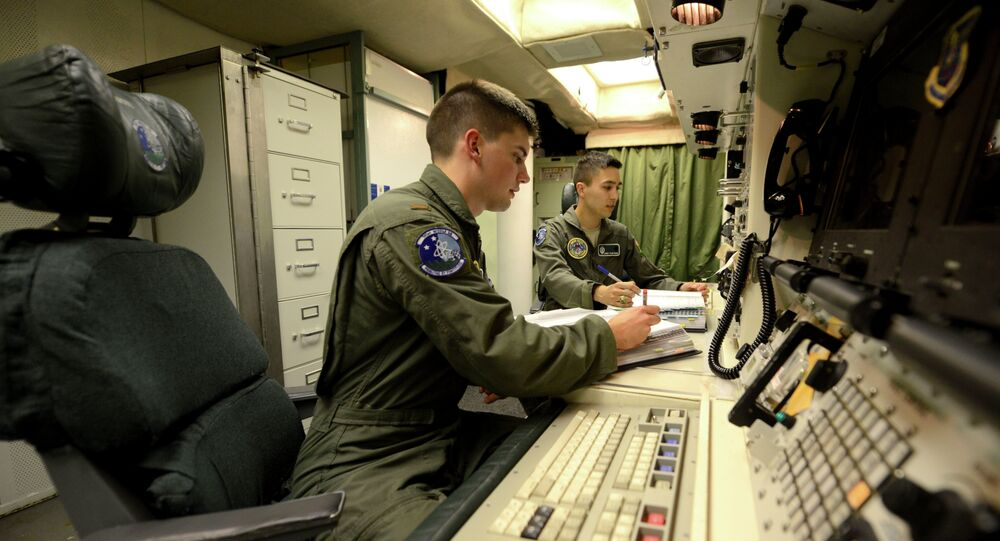 Oliver Parsons, left, and 1st Lt. Andy Parthum check systems in the underground control room where they work a 24-hour shift at an ICBM launch control facility near Minot. (File)