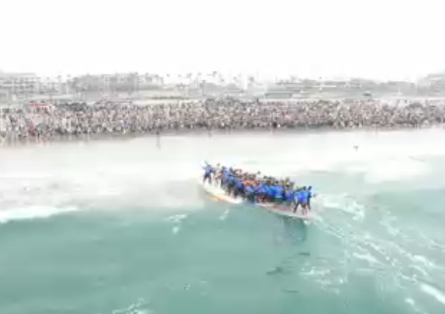 66 Surfers Ride Giant Surfboard To Set World Record