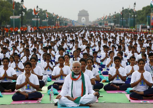 India's Prime Minister Narendra Modi performs yoga with others to mark the International Day of Yoga, in New Delhi, India, June 21, 2015