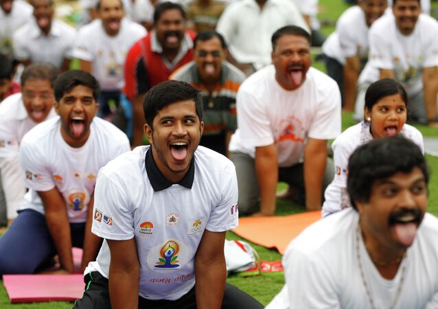 Indians perform yoga at an event to celebrate the International Yoga Day