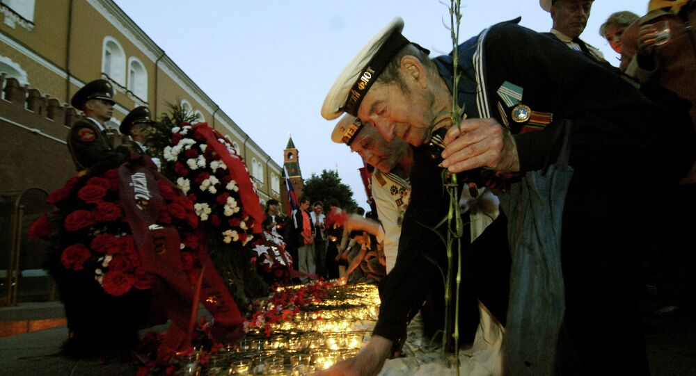 Laying flowers and wreaths before the Eternal Flame at the Tomb of the Unknown Soldier.
