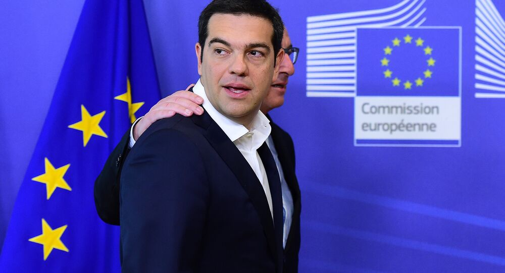 Greece's Prime Minister Alexis Tsipras (L) is welcomed by European Commission President Jean-Claude Juncker ahead of an emergency summit with the leaders of Athens' creditors at the European Commission in Brussels, on June 22, 2015.