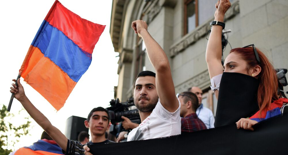 A demonstrator waves an Armenian flag