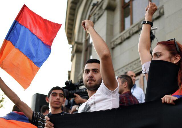 A demonstrator waves an Armenian flag