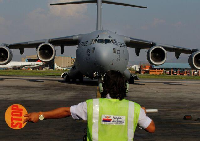A US Air Force Boeing C-17 Globemaster III lands in Tribhuvan International Airport in Kathmandu, Nepal.