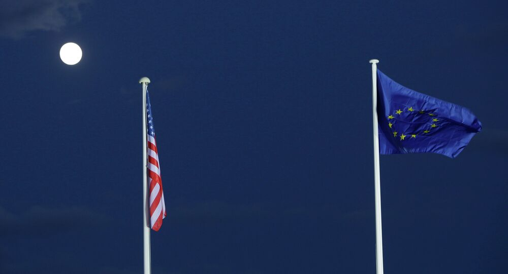 EU and US flags seen beneath the moon