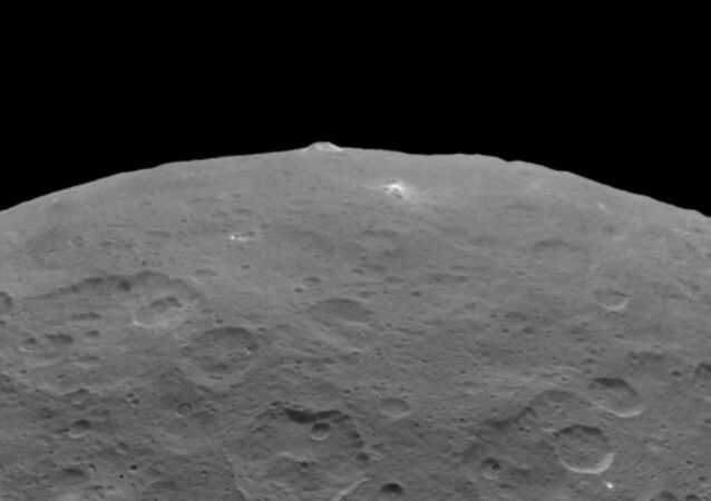 NASA's Dawn probe has taken some more stunning photos of the dwarf planet revealing an inexplicably large pyramid-shaped mountain as well as closer looks at the mysterious bright spots that pepper its surface.
