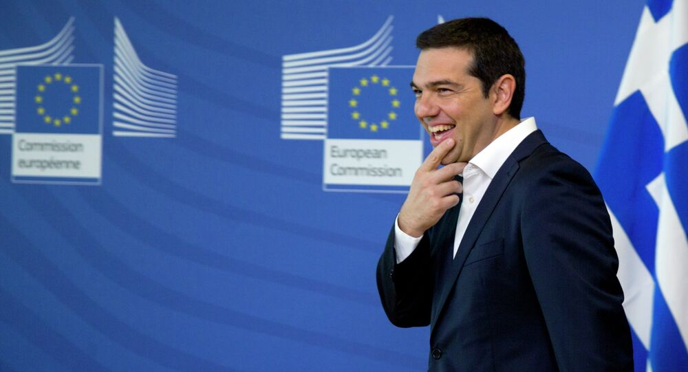 Greek Prime Minister Alexis Tsipras arrives for a meeting with European Commission President Jean-Claude Juncker prior to an EU summit at EU headquarters in Brussels on Monday, June 22, 2015