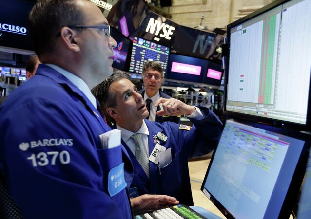 Specialists Anthony Matesic, left, and Anthony Rinaldi, center, work on the floor of the New York Stock Exchange Wednesday, June 17, 2015