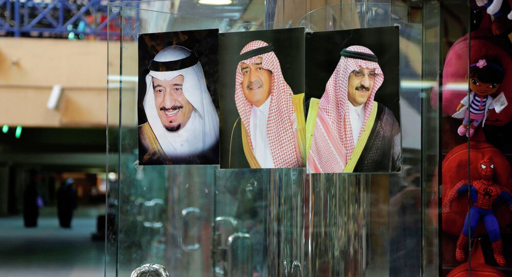 In this April 16, 2015 file photo, images of Saudi King Salman, left, then Crown Prince Muqrin, center, and then Deputy Crown Prince Mohammed bin Nayef are displayed on a shop door at the al Aqeeliya market in Riyadh, Saudi Arabia.