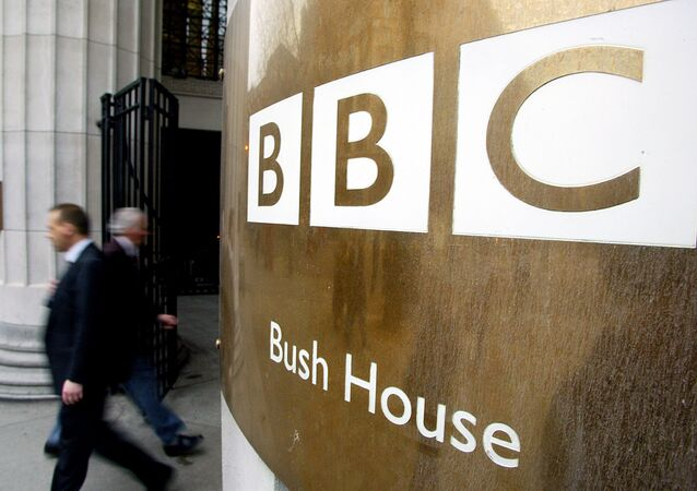Pedestrians walks past the doors of the BBC's Bush House in London. File photo