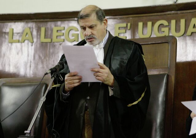 Judge Sergio Silocchi reads the sentence of the appeal trial on a CIA-led kidnapping of an Egyptian terror suspect, Muslim cleric Osama Moustafa Hassan Nasr, also known as Abu Omar, at the Milan's court, Italy, Wednesday, Dec. 15, 2010.
