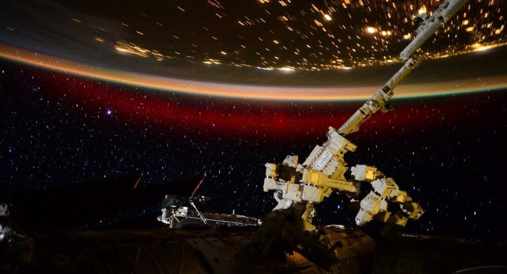 Stationed aboard the International Space Station, US Astronaut Scott Kelly has captured eerie and beautiful photo and video materials of a rare red aurora from 400km above Earth's atmosphere.