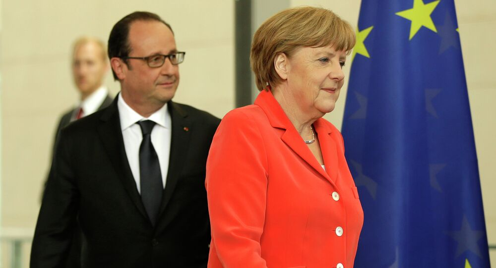 German Chancellor Angela Merkel, right, and the President of France, Francois Hollande, left, arrive for a joint press conference as part of a meeting at the Chancellery in Berlin, Germany, Tuesday, May 19, 2015