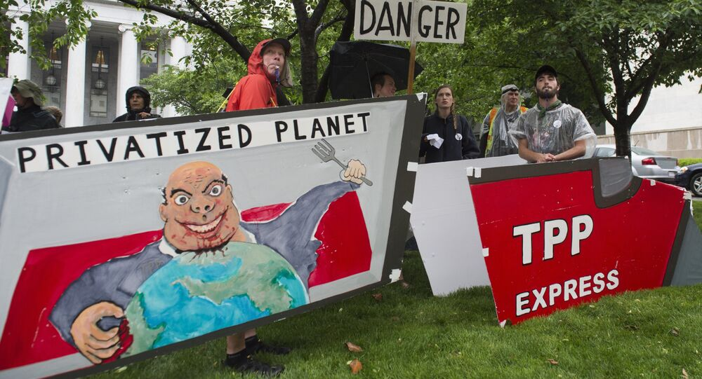 Demonstrators protest against the legislation to give US President Barack Obama fast-track authority to advance trade deals, including the Trans-Pacific Partnership (TPP), during a protest march on Capitol Hill in Washington