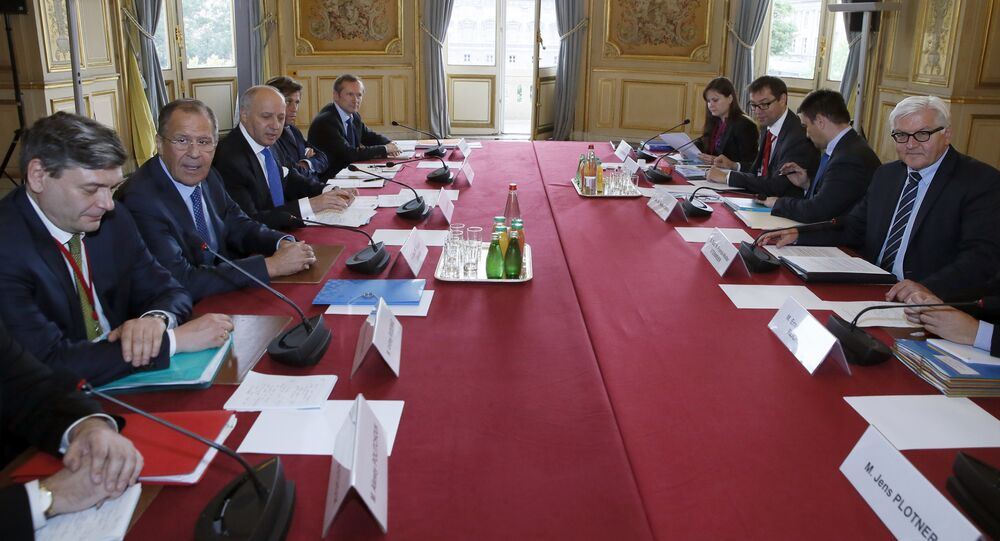 French foreign affairs minister Laurent Fabius (3L) attends a meeting with Russian Foreign Minister Sergei Lavrov (2L), German Foreign Minister Frank-Walter Steinmeier (R) and Ukrainian Minister of Foreign Affairs Pavlo Klimkin (2R) during a meeting on Ukraine, on June 23, 2015 in Paris