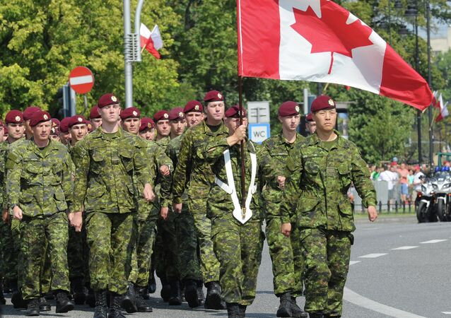 A military unit from Canada marches during a military parade marking Polish Armed Forces Day, in Warsaw, Poland, Friday, Aug. 15, 2014