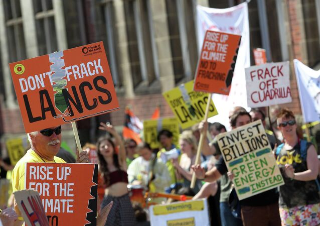 Anti-Fracking protesters demonstrate outside Lancashire County Hall in Preston, northwest England, on June 23, 2015