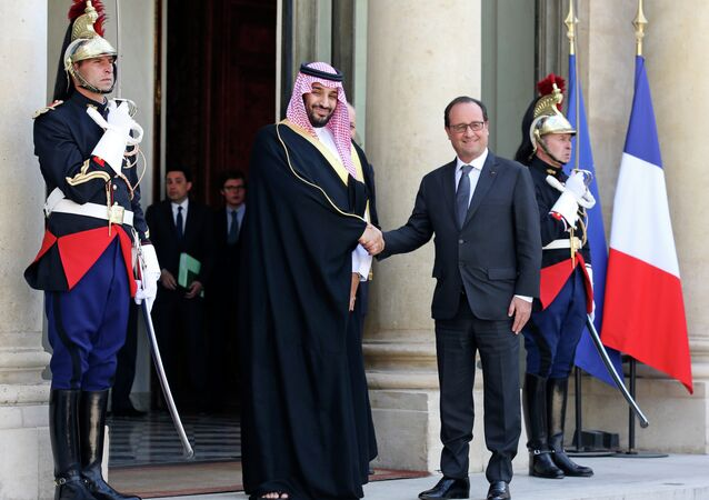 French President Francois Hollande, right, shakes hand with Saudi Arabia's Defense Minister Prince Mohammed Bin Salman prior to their meeting at the Elysee Palace in Paris.