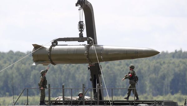 A file photo showing Russian servicemen equip an Iskander tactical missile system at the Army-2015 international military-technical forum in Kubinka, outside Moscow, Russia, June 17, 2015 - Sputnik International