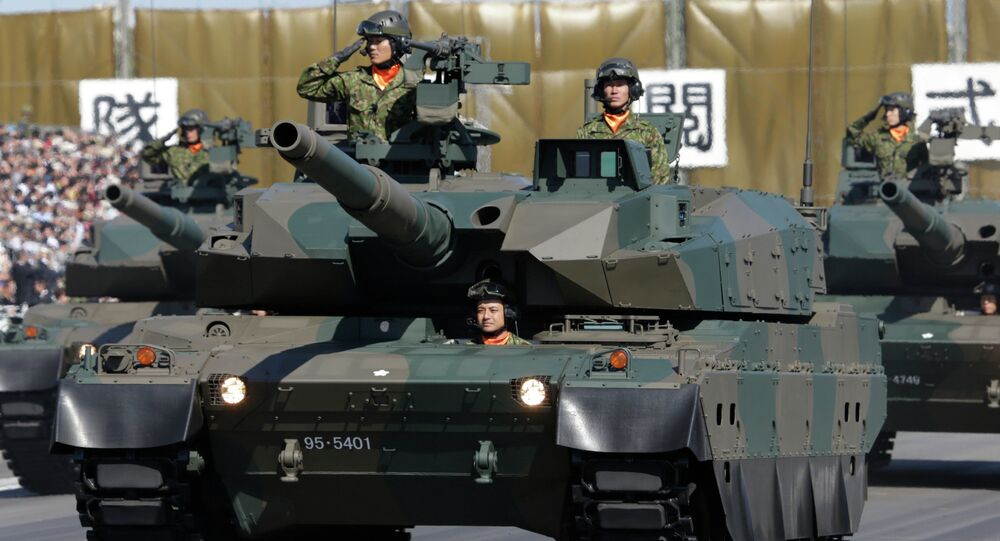 Members of the Japan Ground Self-Defense Force salute from Type 90 tanks at a parade during the Self-Defense Forces Day at Asaka Base, north of Tokyo (File)