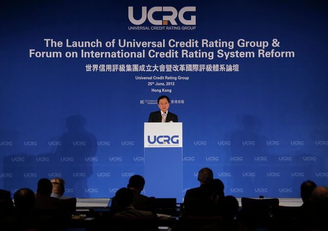 Guan Jianzhong, chairman of the Universal Credit Rating Group, delivers his speech at the launch ceremony in Hong Kong Tuesday, June 25, 2013
