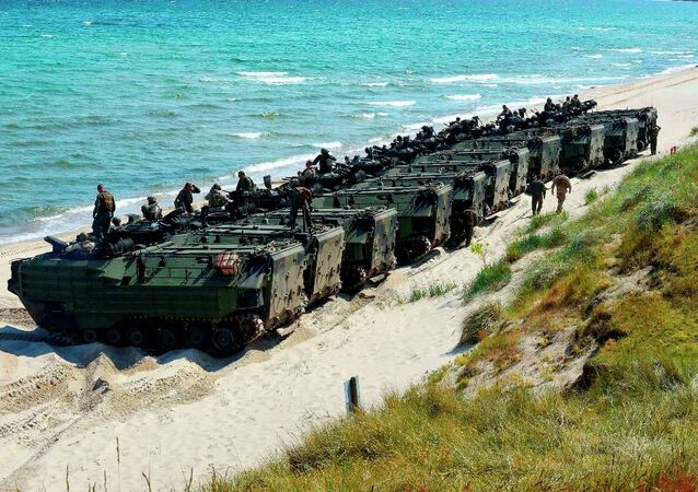 United States Marine Corps amphibious assault vehicles line up to return to their ship following an amphibious assault exercise during Baltic Operations (BALTOPS) 2015.