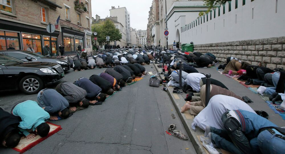 Muslims pray in the street outside the Mosque in Paris