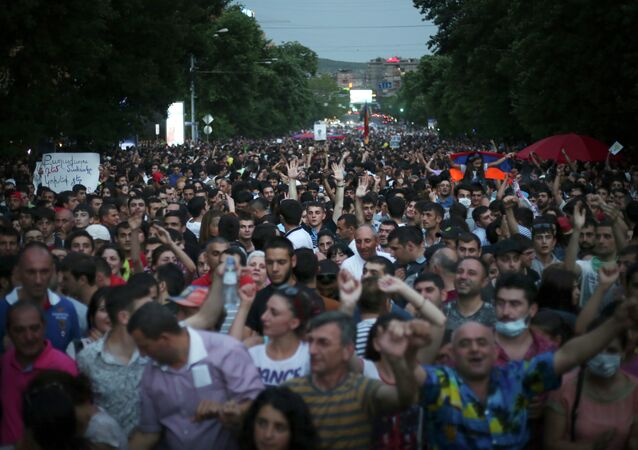 Armenian protesters march during a protest rally against a hike in electricity prices in Yerevan, Armenia, Wednesday, June 24, 2015