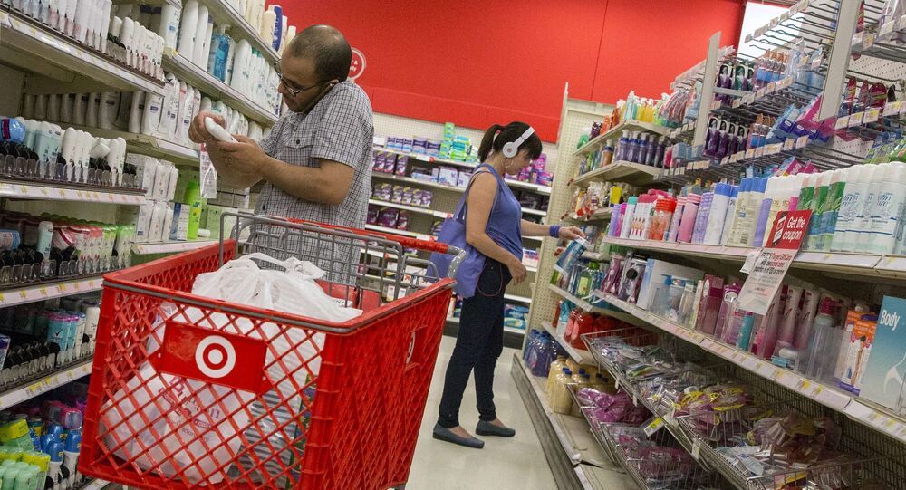Customers shop in the pharmacy department of a Target store in New York, in this file photo taken June 15, 2015