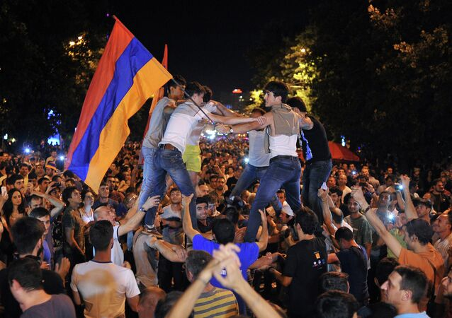 Protesters block a street during a demonstration against an increase of electricity prices in Yerevan early on June 25, 2015