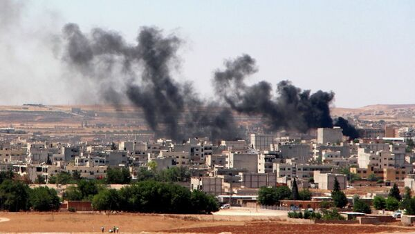 Smoke billow from the Syrian town of Kobane, as seen from the Turkish side of the border in Suruc in Sanliurfa province on June 25, 2015. Turkey denied baseless claims that Islamic State (IS) militants reentered the Syrian town of Kobane through the Turkish border crossing to detonate a suicide bomb, - Sputnik International