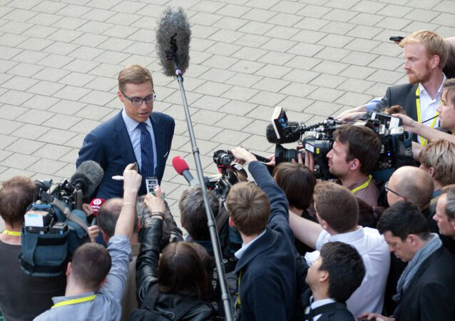 Finland's Finance Minister Alexander Stubb speaks with the media after a meeting of eurogroup finance ministers at the EU LEX building in Brussels on Wednesday, June 24, 2015