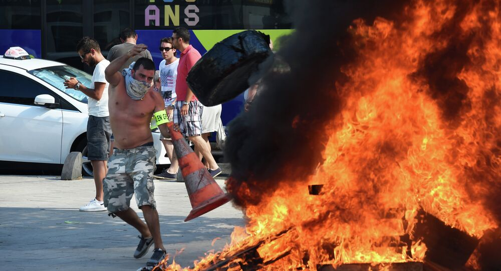 French Taxi drivers protest in the southern city of Marseille on June 25, 2015 as they demonstrate against UberPOP.