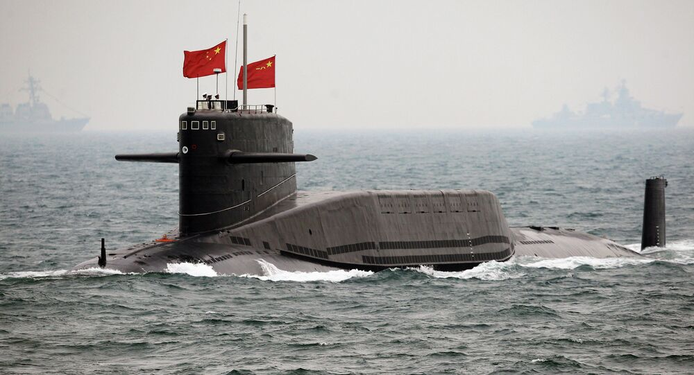 File photo, a Chinese Navy nuclear-powered submarine sails during an international fleet review to celebrate the 60th anniversary of the founding of People's Liberation Army Navy