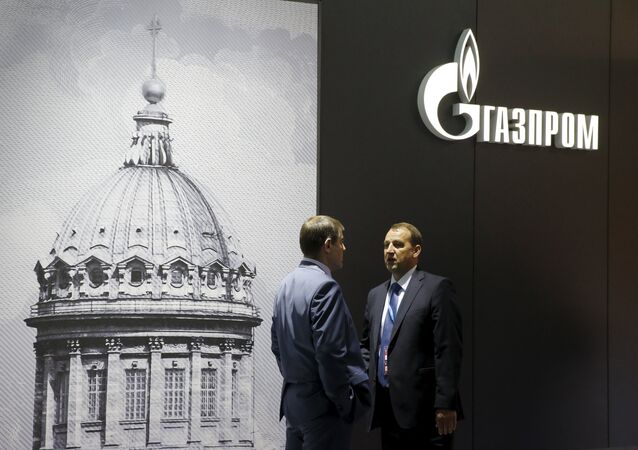 Men speak near the pavilion of Gazprom company at the St. Petersburg International Economic Forum 2015 (SPIEF 2015) in St. Petersburg, Russia, June 18, 2015