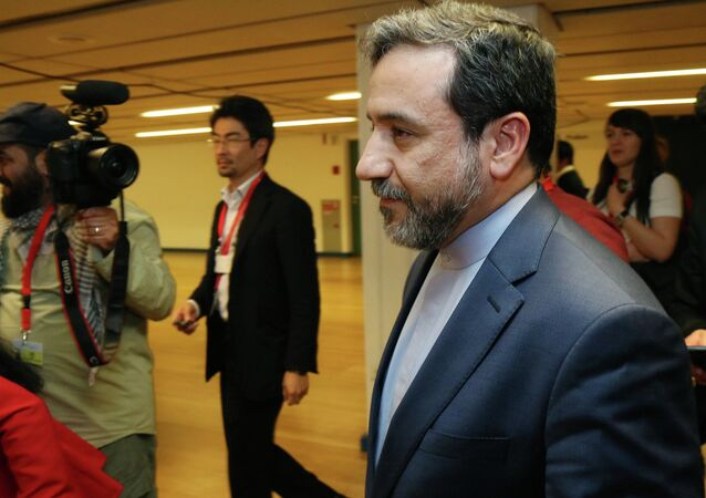 Iran's deputy Foreign Minister Abbas Araghchi arrives for a press briefing for Iranian journalists after the closed-door nuclear talks at the International Center in Vienna, Austria, Friday, May 16, 2014