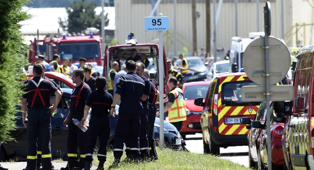 French police and firefighters gather at the entrance of the Air Products company in Saint-Quentin-Fallavier, near Lyon, central eastern France, on June 26, 2015