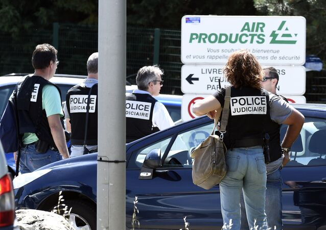French police secure the entrance of the Air Products company in Saint-Quentin-Fallavier, near Lyon, central eastern France, on June 26, 2015