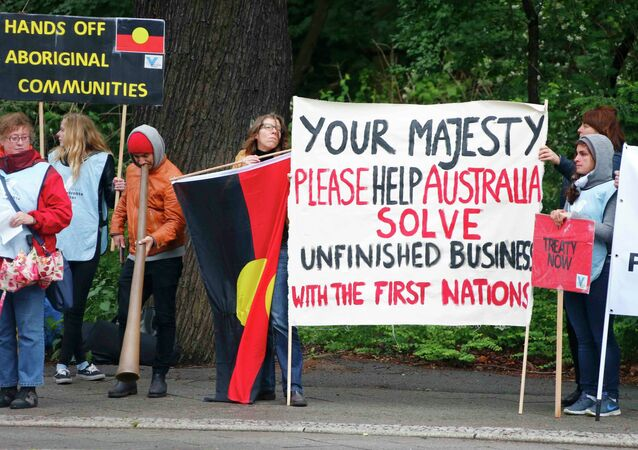 Protestors demonstrate for more rights of Aboriginal Australians in Berlin, Germany June 24, 2015, during the state visit of Britain's Queen Elizabeth and Prince Philip