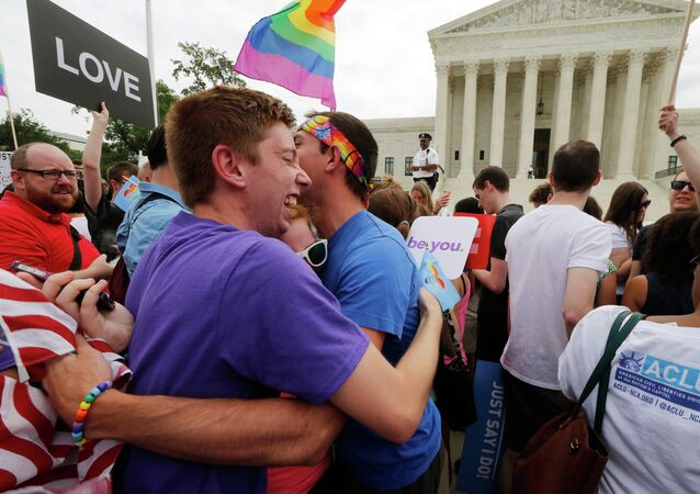 Gay rights supporters celebrate after the U.S. Supreme Court ruled that the U.S. Constitution provides same-sex couples the right to marry, outside the Supreme Court building in Washington, June 26, 2015