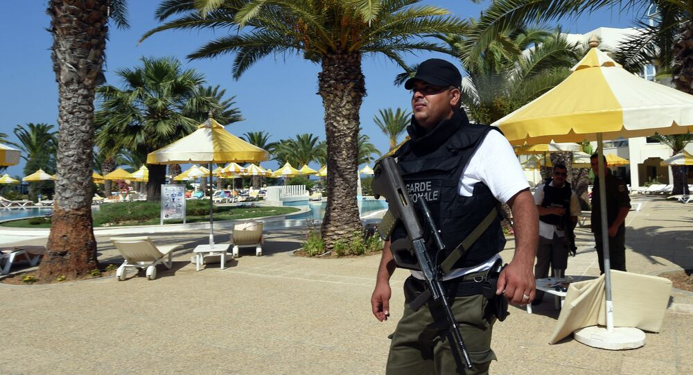 A Tunisian security member stands next to a swimming pool at the resort town of Sousse, a popular tourist destination 140 kilometres (90 miles) south of the Tunisian capital, on June 26, 2015, following a shooting attack.