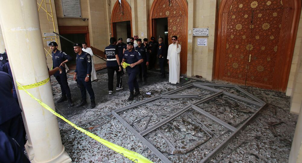 Kuwaiti security forces gather outside the Shiite Al-Imam al-Sadeq mosque after it was targeted by a suicide bombing during Friday prayers on June 26, 2015, in Kuwait City