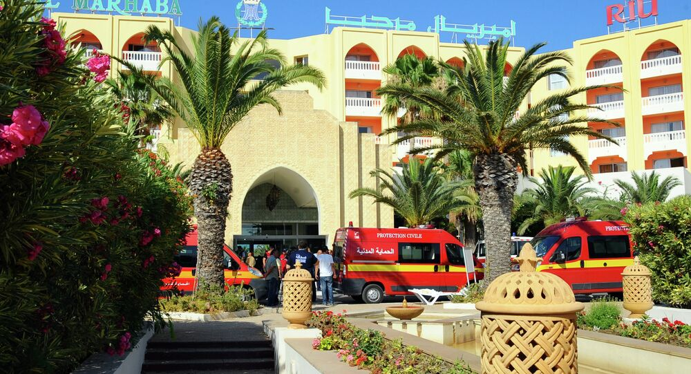 Injured people are treated near the area where an attack took place in Sousse, Tunisia, Friday June 26, 2015