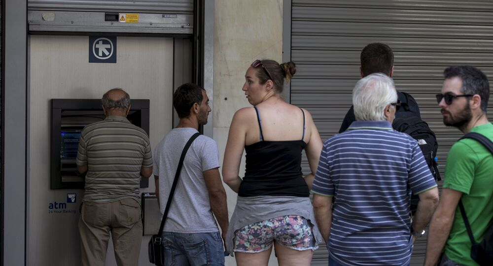 People line up at an automated teller machine (ATM) outside an Alpha Bank branch in Athens, Greece June 27, 2015