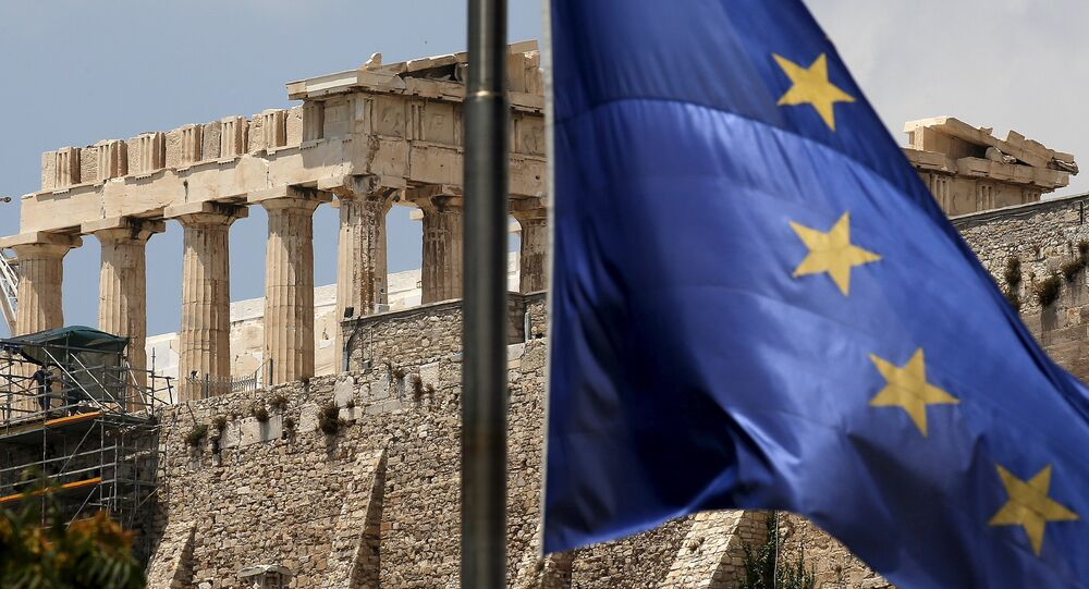 A European Union flag flutters before the temple of Parthenon at the Acropolis hill in Athens, Greece
