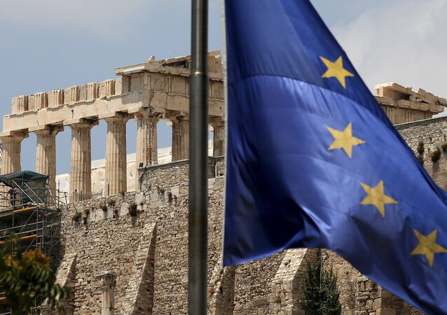 A European Union flag flutters before the temple of Parthenon at the Acropolis hill in Athens, Greece.