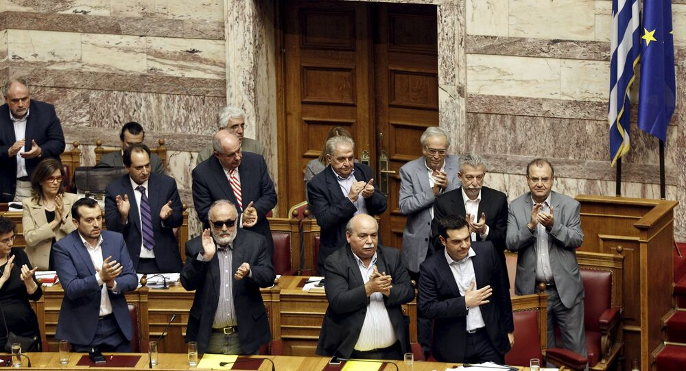 Greek Prime Minister Alexis Tsipras (bottom R) acknowledges applause during a parliamentary session in Athens, Greece June 28, 2015